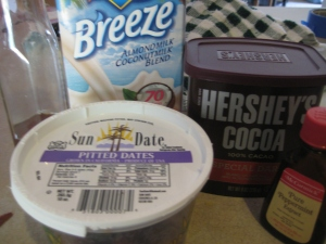 Nondairy milk, dates and cocoa powder